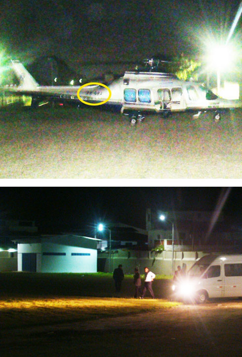 Helicóptero do Estado, no círculo amarelo a marca GRJ (Governo do Rio de Janeiro); abaixo, Cabral de camisa clara