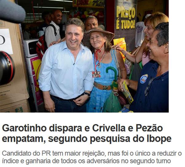 Garotinho ontem em Itaboraí; abaixo reprodução de O Dia online